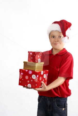 Spirit of Giving stock photo, Child wearing red polo and jeans holding three gift boxes. by Leah-Anne Thompson