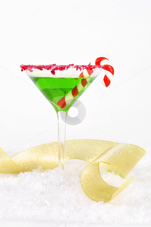 Christmas Party stock photo, Christmas Party - Green drink with red edge and curling gold ribbon on white. - vertical by Leah-Anne Thompson
