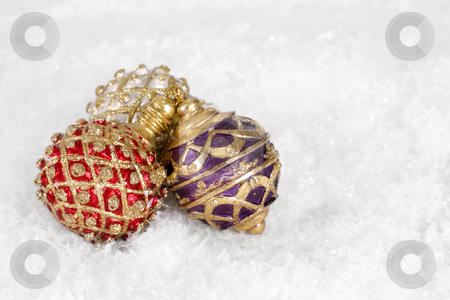Christmas Decorations stock photo, Three Christmas decorations on snow