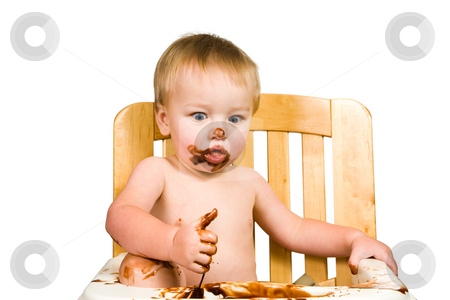 Messy Baby Boy Isolated stock photo, A portrait of a messy baby boy isolated eating chocolate. by Travis Manley