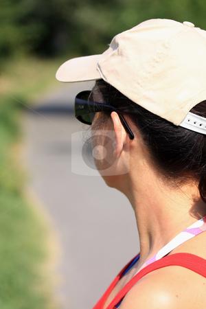 Baseball cap stock photo, Young girl with baseball cap looking by ARPAD RADOCZY