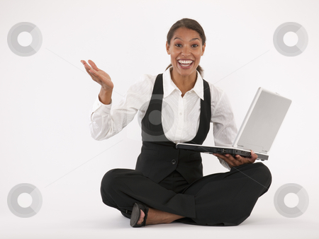 Young Woman Using Laptop stock photo, Young woman sitting on floor using laptop. Horizontally format. by Edward Bock