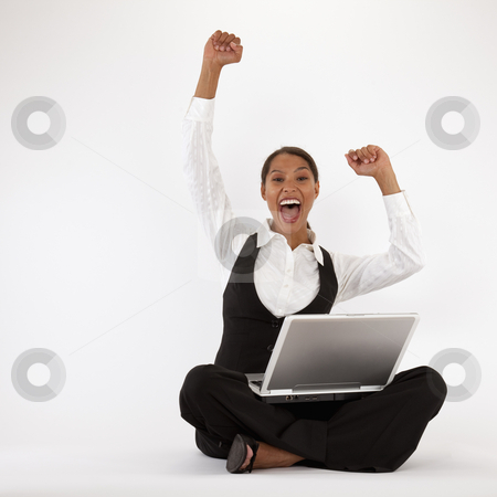 Young Woman Using Laptop stock photo, Young woman sitting on floor using laptop. Square format. by Edward Bock