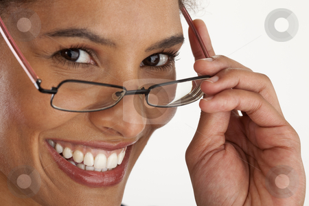 Young Woman Wearing Glasses stock photo, Closeup of young woman wearing glasses. Horizontally framed shot. by Edward Bock