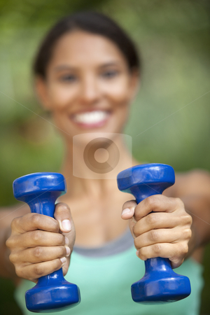 Young Woman Exercising stock photo, Young woman exercising in outdoor setting. Vertically framed shot. by Edward Bock
