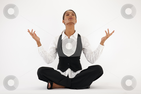 Young Woman Meditating stock photo, Young woman sitting cross legged and meditating. Horizontally framed shot. by Edward Bock