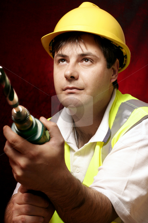 Tradesmen with a drill stock photo, Tradesmen with drill and large drill bit. by Leah-Anne Thompson