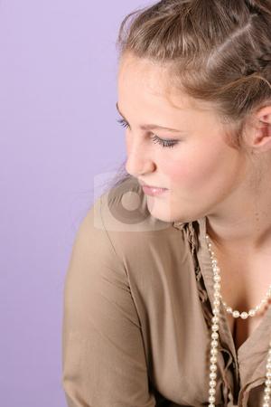 Teenager stock photo, Beautiful teenage female against purple background, wearing pearls by Vanessa Van Rensburg