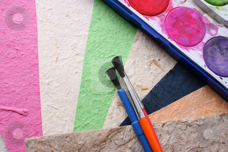 Paint stock photo, Paint Brushes, Paint and different colored handmade paper by Vanessa Van Rensburg