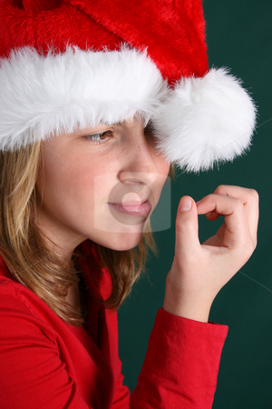 Christmas Boredom stock photo, Teenager in red shirt and fluffy christmas hat by Vanessa Van Rensburg