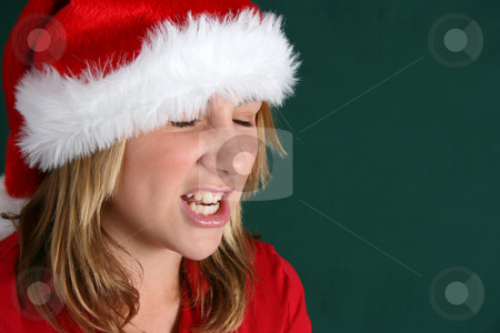 Annoyed with Christmas stock photo, Annoyed teenager expressing her feelings about christmas by Vanessa Van Rensburg
