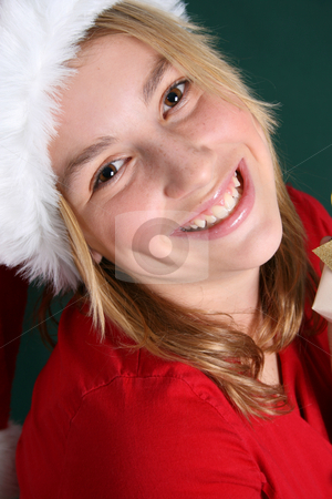 Christmas Teen stock photo, Christmas teen wearing a red hat with a big smile by Vanessa Van Rensburg