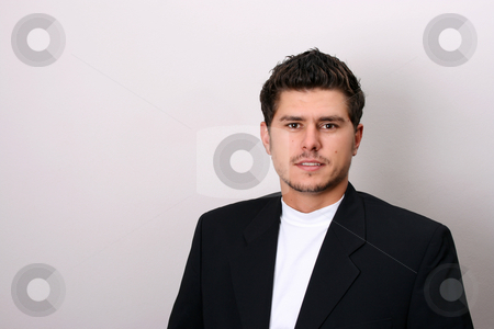 Male Model stock photo, Male model in studio against white wall by Vanessa Van Rensburg