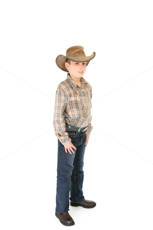 County boy wearing a cowboy hat stock photo, A country boy wearing a shirt jeans and leather cowboy hat. by Leah-Anne Thompson