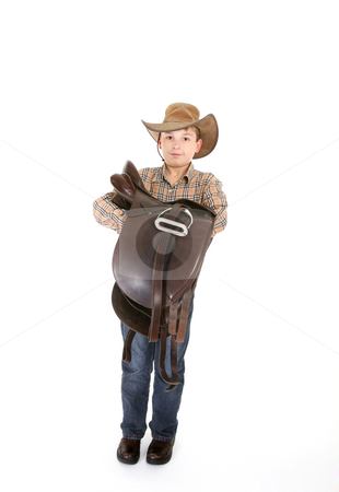 Boy carrying a saddle stock photo, Boy holding a leather saddle in his arms. by Leah-Anne Thompson