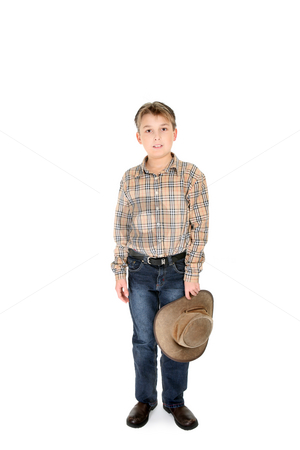 Country boy holding hat stock photo, Country boy in jeans and check shirt holding a leather hat. by Leah-Anne Thompson