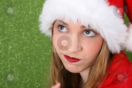 Christmas Teen stock photo, Christmas teen wearing a red hat with facial expression by Vanessa Van Rensburg
