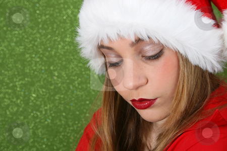 Christmas Dissapointment stock photo, Christmas teen wearing a red hat, looking dissapointed by Vanessa Van Rensburg