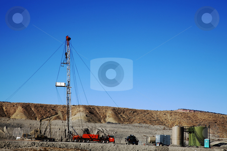 Oil Well stock photo, Oil well with Storage Tanks in the Background by Mark Smith