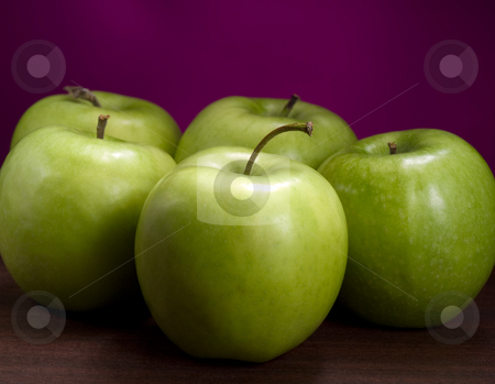 Green ripe apples stock photo, Fresh green apples on the wooden table , closeup shot against purple background by Vladimir Koletic