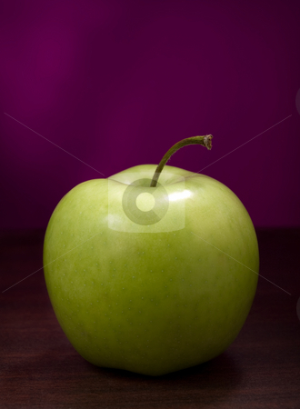 Ripe green apple stock photo, Green apple on the wooden table against the purple background by Vladimir Koletic