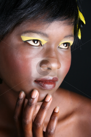 Female Model stock photo, Beautiful young African female model with feathers by Vanessa Van Rensburg