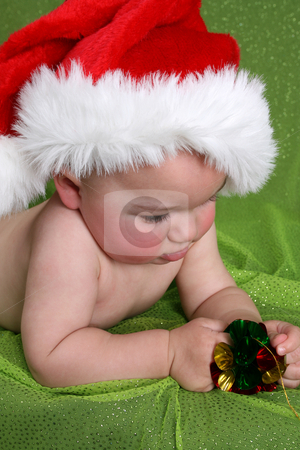 Christmas Boy stock photo, Baby lying on his tummy, wearing a christmas hat by Vanessa Van Rensburg