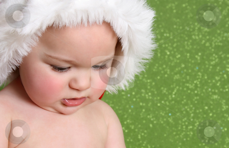 Christmas Baby stock photo, Christmas Baby looking down on a green background by Vanessa Van Rensburg