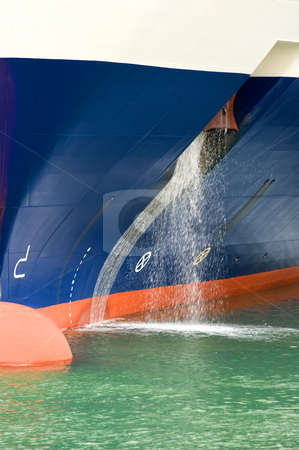 Flushing stock photo, The bow of a big passenger ship, with water flushing through the anchor bay by Corepics VOF