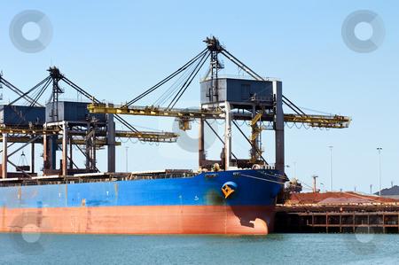Bulk carrier stock photo, Huge cranes unloading ore from a bulk carrier by Corepics VOF