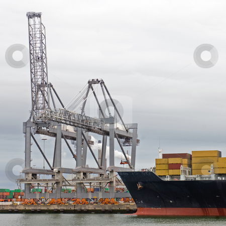 Industrial harbor stock photo, Huge container vessel, moored off at an industrial harbor facility, ready to be unloaded by Corepics VOF