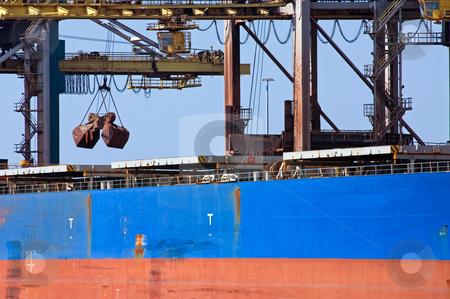 Bulk carrier stock photo, A huge crane unloading ore from a bulk carrier by Corepics VOF