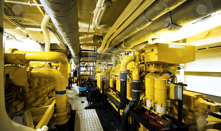 Engine room stock photo, The engine room with the water pupms to power the fire extinguishers of a fire boat by Corepics VOF
