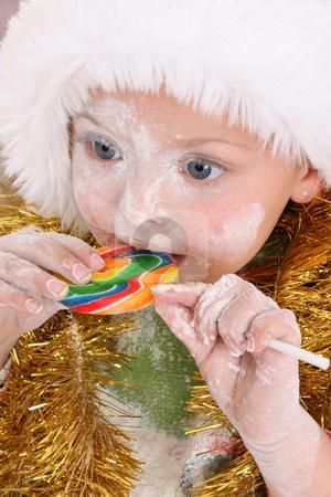 Rewards stock photo, Christmas toddler got a lollipop reward for baking cookies by Vanessa Van Rensburg