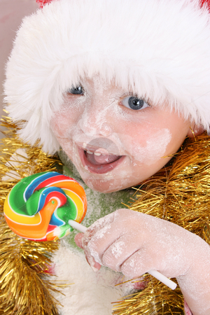 Rewards stock photo, Christmas toddler got a lollipop reward for baking cookies by Vanessa Van Rensburg