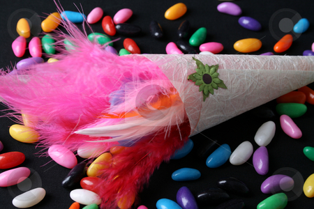 Feather Confetti stock photo, Brightly colored feather confetti in a cone by Vanessa Van Rensburg
