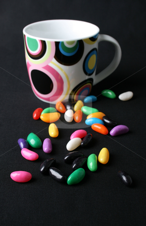 Jelly Beans and Mug stock photo, Jelly beans and a mug on a black background by Vanessa Van Rensburg