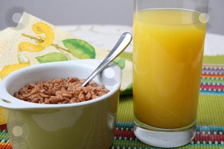Breakfast stock photo, Cereal in a green bowl with orange juice by Vanessa Van Rensburg