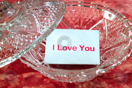 Love Letter stock photo, A love letter sitting in a glass candy dish which says,