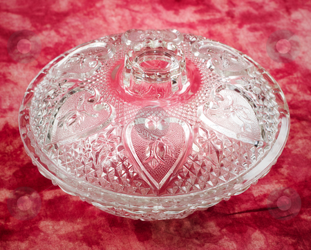 Glass Candy Dish stock photo, A glass candy dish with hearts shot on a red background by Richard Nelson