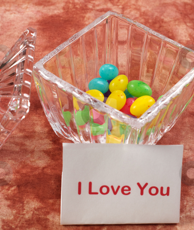 I Love You Note stock photo, A bowl of candy and a note saying I love you, with focus on the candy by Richard Nelson