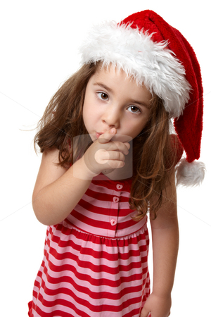 Santa girl hushing or gesturing for quiet stock photo, Adorable little girl dressed in a red and pink striped dress and wearing a red santa hat, gestures with finger to lips for silence or quiet. by Leah-Anne Thompson