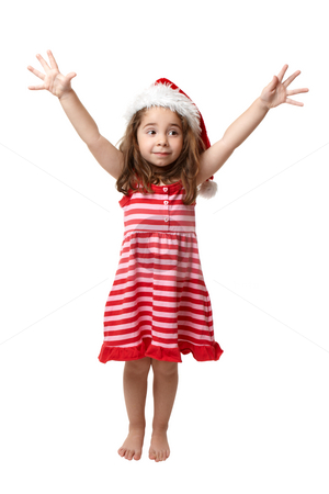 Christmas Girl with hands in the air stock photo, Little Christmas girl with hands outstreched and she is looking sideways by Leah-Anne Thompson