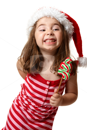 Christmas girl with cheeky smile stock photo, Little Christmas girl wearing a santa hat and showing a cheesy toothy smile by Leah-Anne Thompson