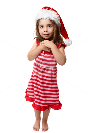 Happy little Christmas santa girl stock photo, Gushing amazed and happy little Christmas girl in red and pink striped dress and red santa hat. by Leah-Anne Thompson