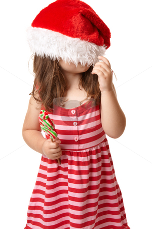 Christmas child with santa hat stock photo, Christmas child playing with santa hat by Leah-Anne Thompson