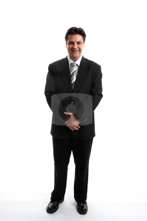Businessman stock photo, Businessman standing on a plain white background. by Leah-Anne Thompson