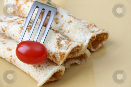 Pancakes and Tomato stock photo, Close up of pancakes on a yellow plate by Vanessa Van Rensburg
