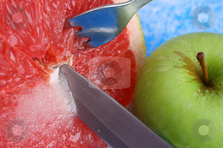 Apple and Pomelo stock photo, Sliced Pomelo with Sugar and a knife, fork and apple by Vanessa Van Rensburg