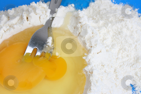 Egg and Flour stock photo, Raw egg and flower with a fork in the yolk by Vanessa Van Rensburg